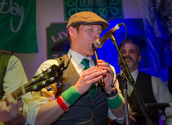 Former H+A Associate, Jeremy Bauer, Plays his Irish Whistle with Coming Up Threes