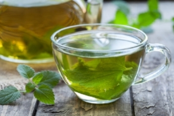 a cup of lemon balm tea tastes delicious and is calming