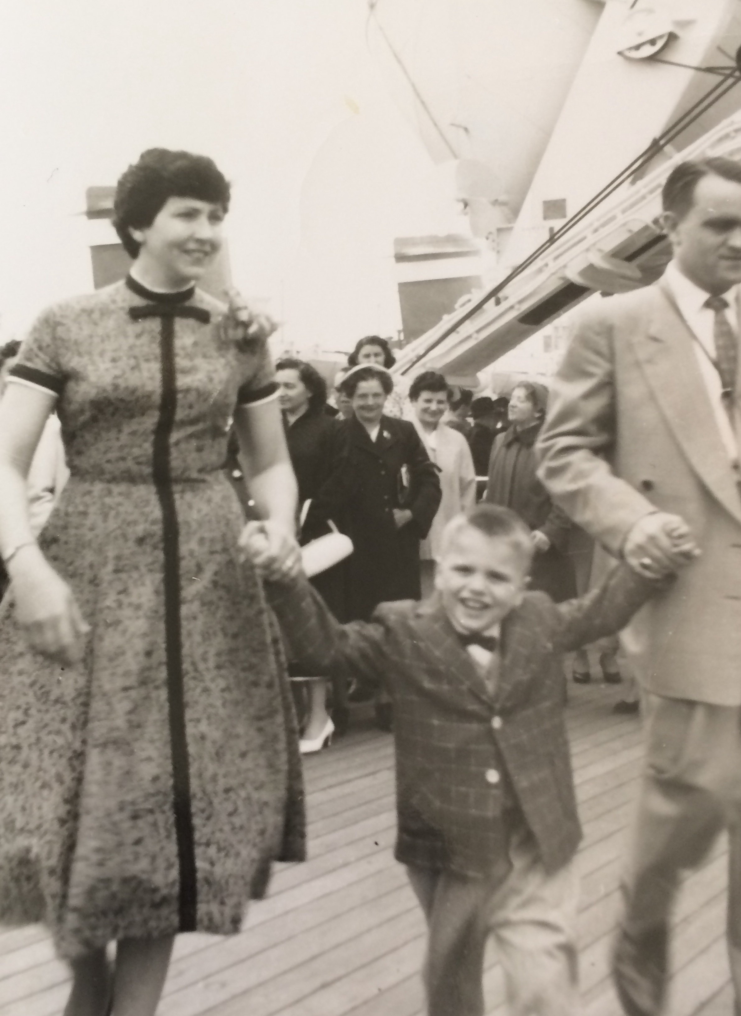 My father and his parents, either coming or going from a boat to the old country.
