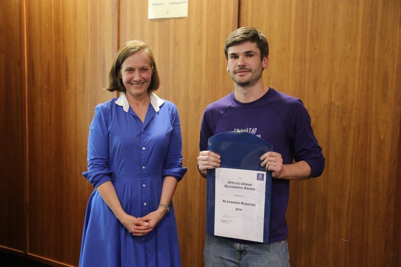 Geografia Board Director, Liz Grainger awards the prize to Alexander Rossiter