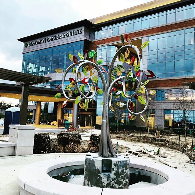 Just installed - stainless steel and fused glass contemplative garden tree for Parkview Cancer Center. Fountain is still under construction.#healingarts #healthcareart #treesculpture #stainlesssteelsculpture #stainlesssteeltree