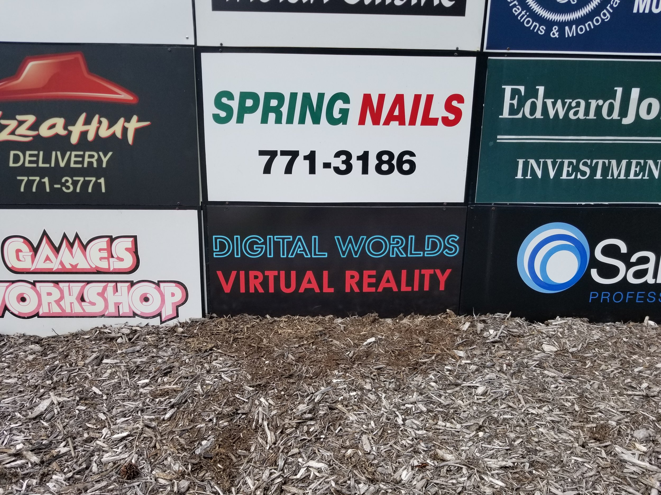 Image of the Digital Worlds VR Arcade Monument Sign With Larger Virtual Reality Franklin Tennessee.