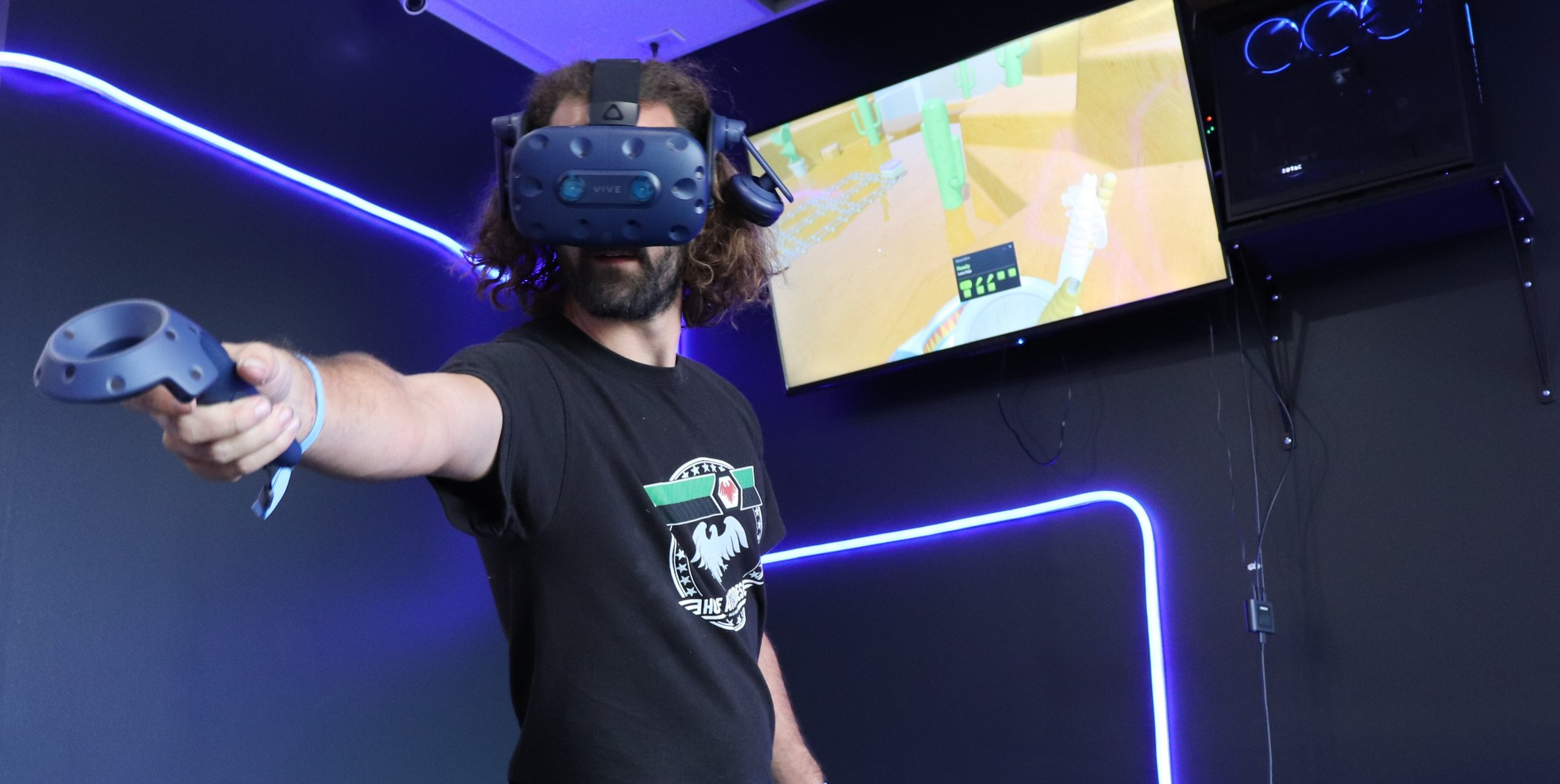 Photo of a player in a VR game called Loco Dojo which is a Virtual Reality party game for groups playing at Digital Worlds arcade in Franklin Tennessee.