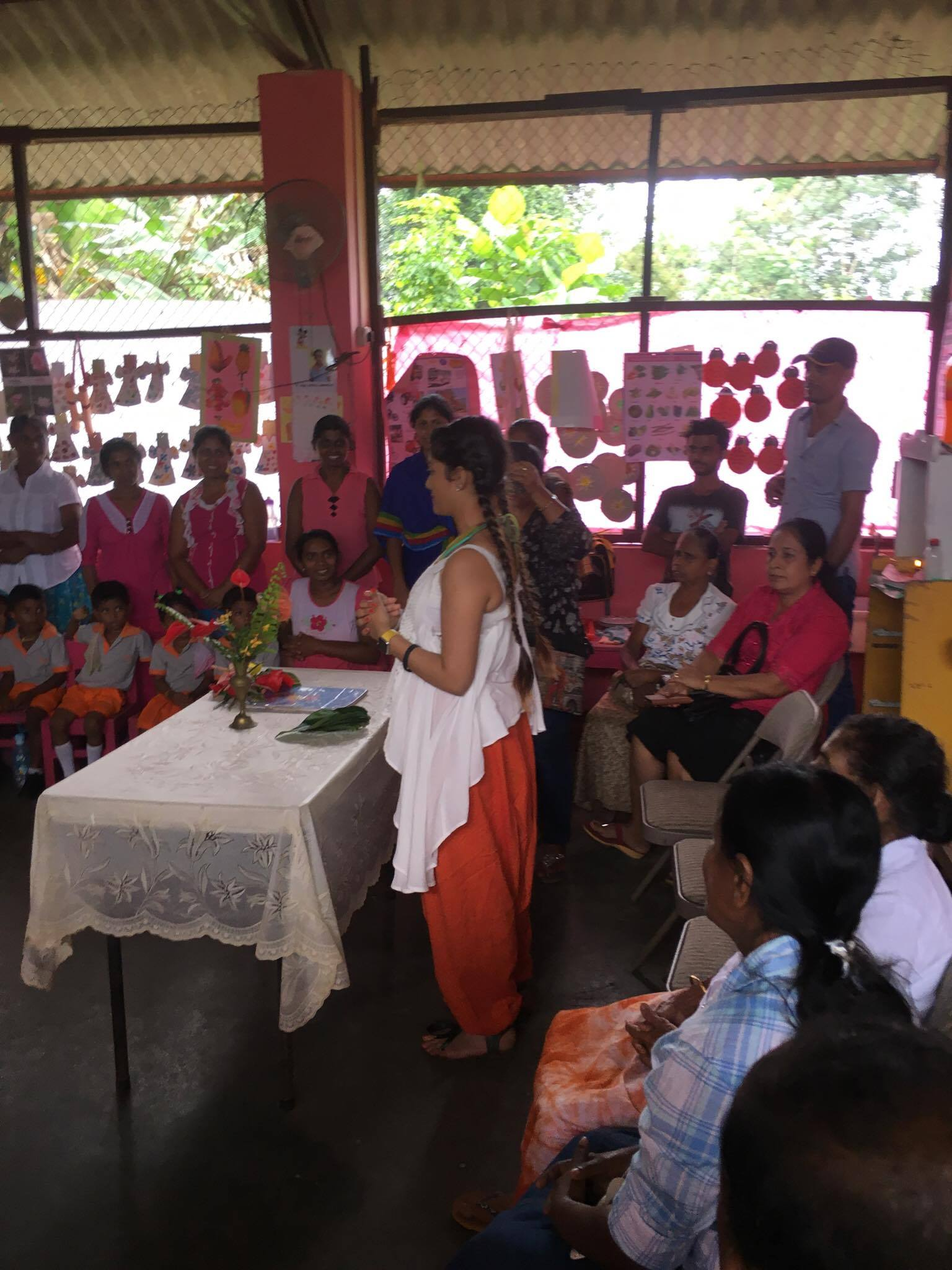 Julia Wijesinghe giving a speech to the students parents at Ratanphura.