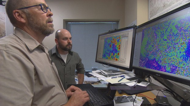 Chief scientist Ian Madin and arborist Brian French review LiDar data at DOGAMI.  Todd Sonflieth/OPB