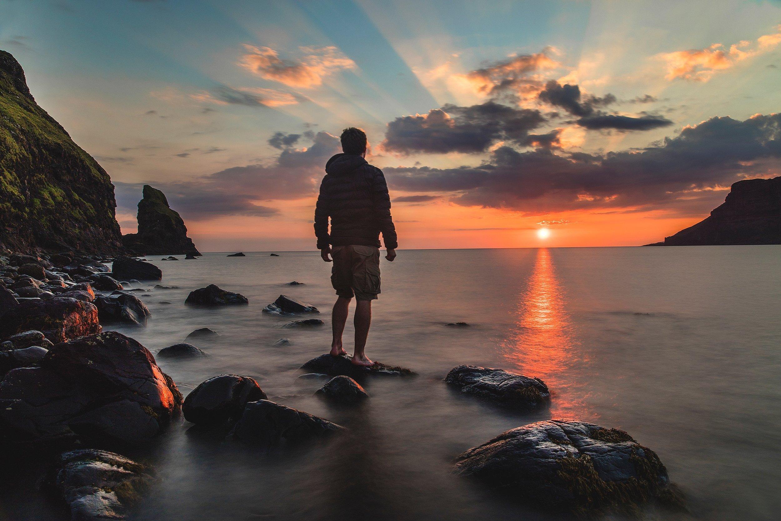 Man looking at sunrise - philosophy.jpg