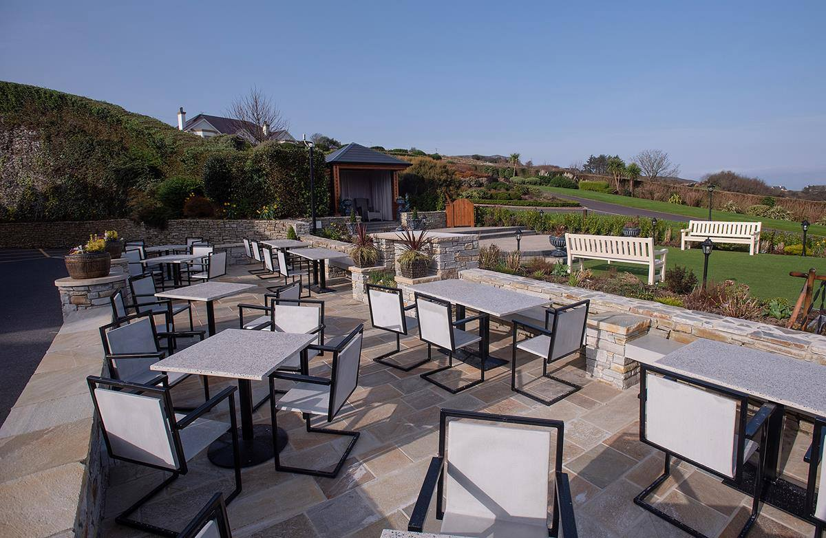 Balcrete outdoor furniture commissioned by Ballyliffin Lodge & Spa. Guests enjoy panoramic views of Malin Head and the world famous Ballyliffin Golf Club from the patio.