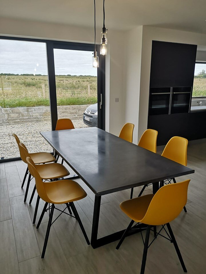 Concrete dining table and chairs in Charcoal.jpg