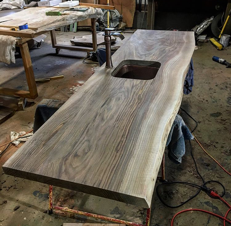 Black walnut countertop with hand pounded copper sink