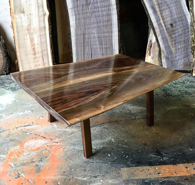 Black walnut coffee table sitting on a handcrafted black walnut legs