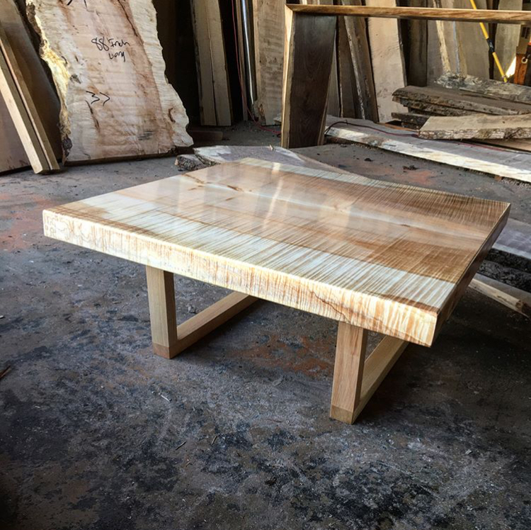 Figured maple coffee table on handcrafted maple legs