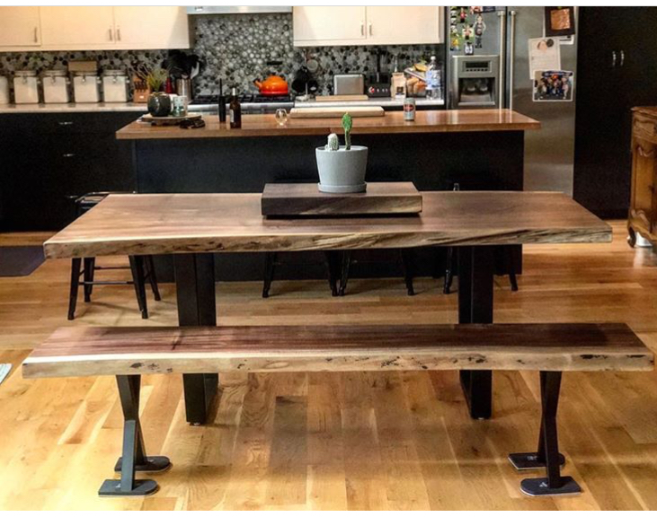 Black walnut dining table with steel legs and matching bench