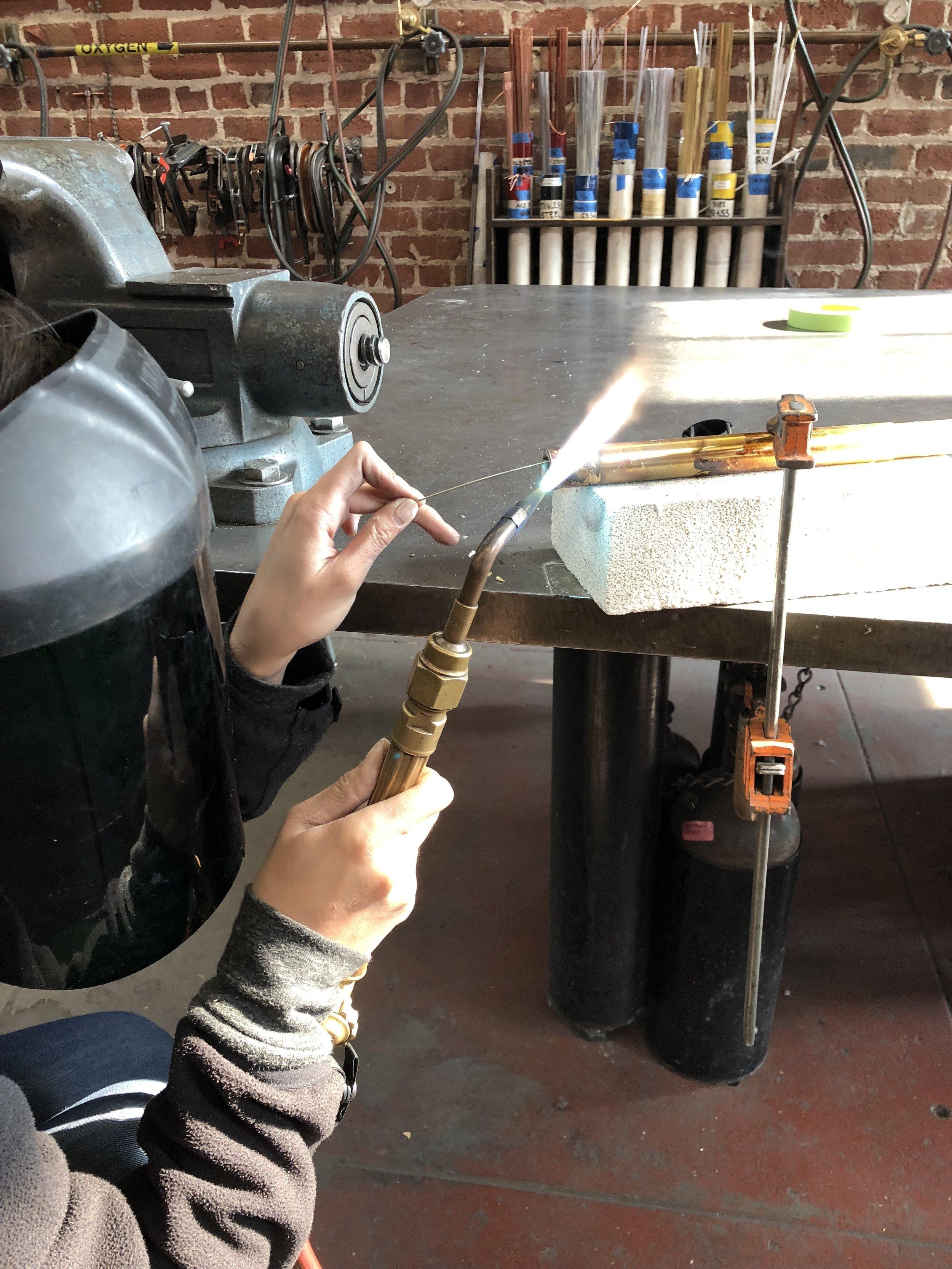 Welding - Brazing Plugs in Table Legs.JPG