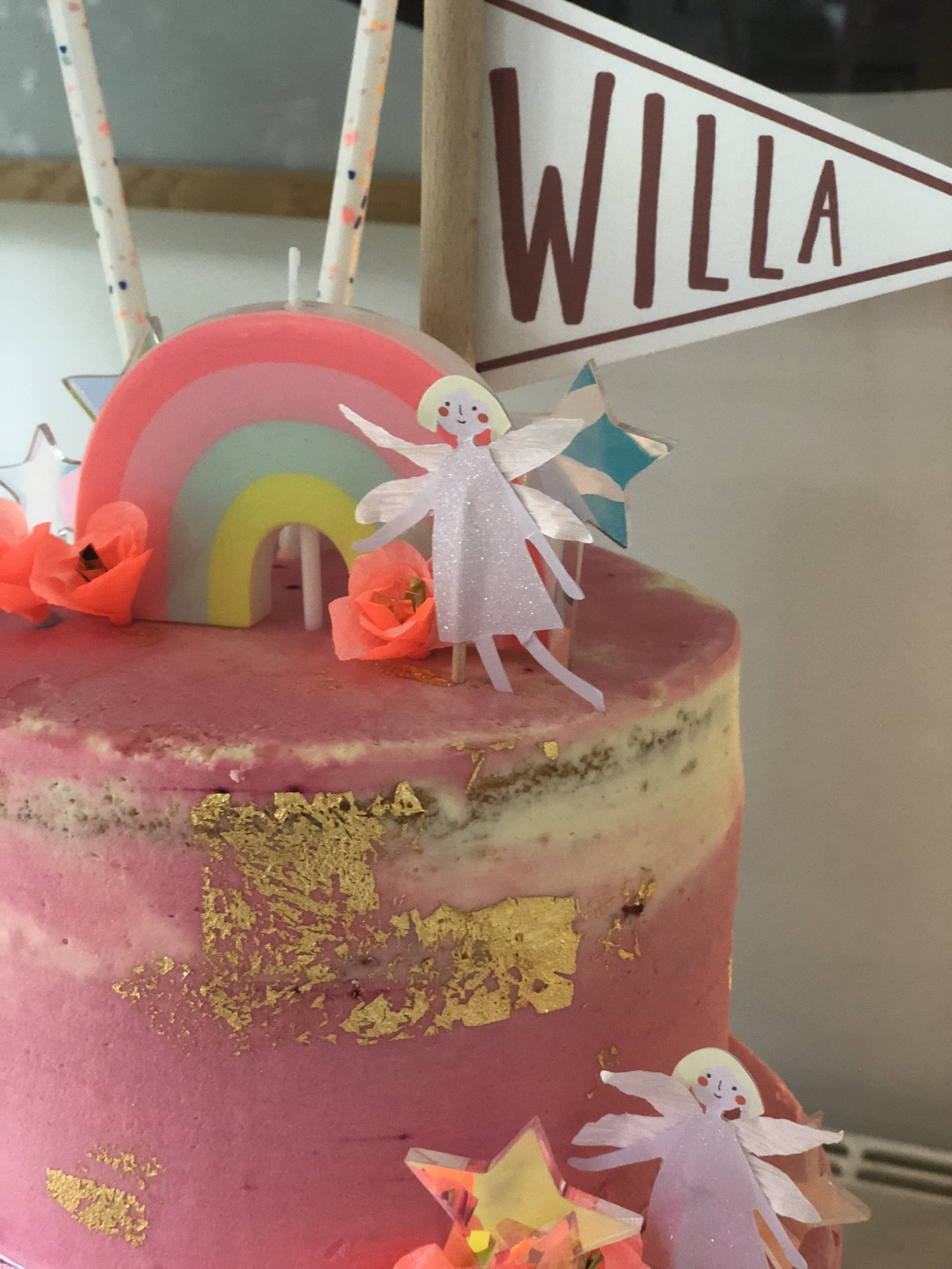 The cake which was candy pink flecked with gold.
