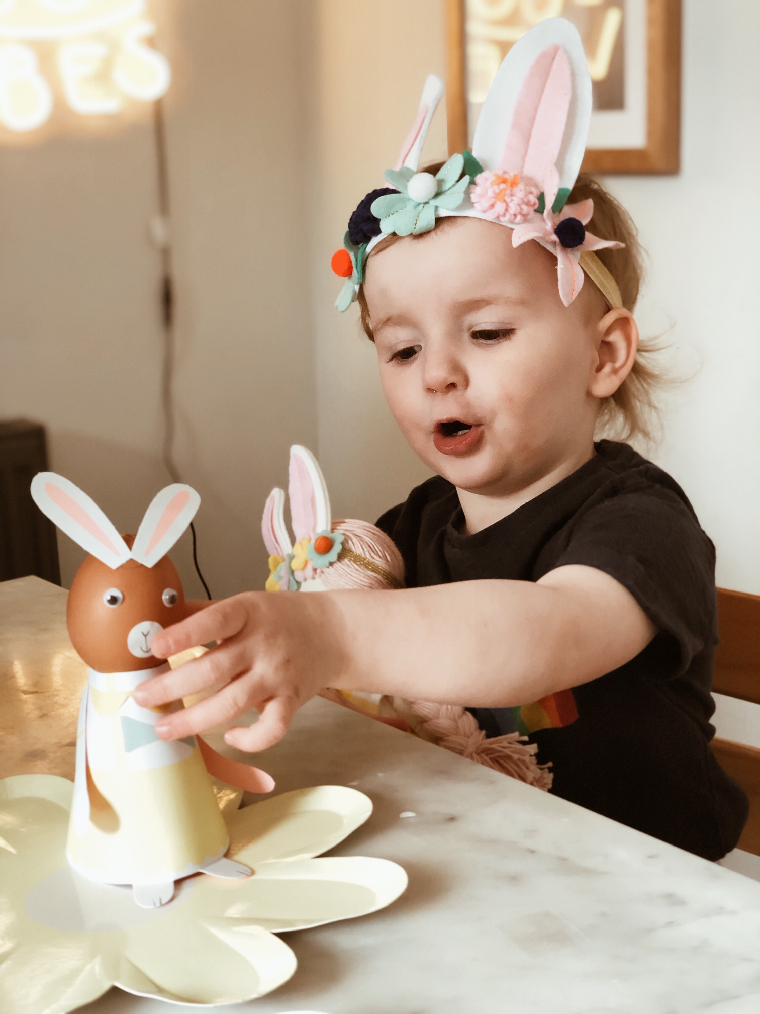 Decorating her bunny egg!