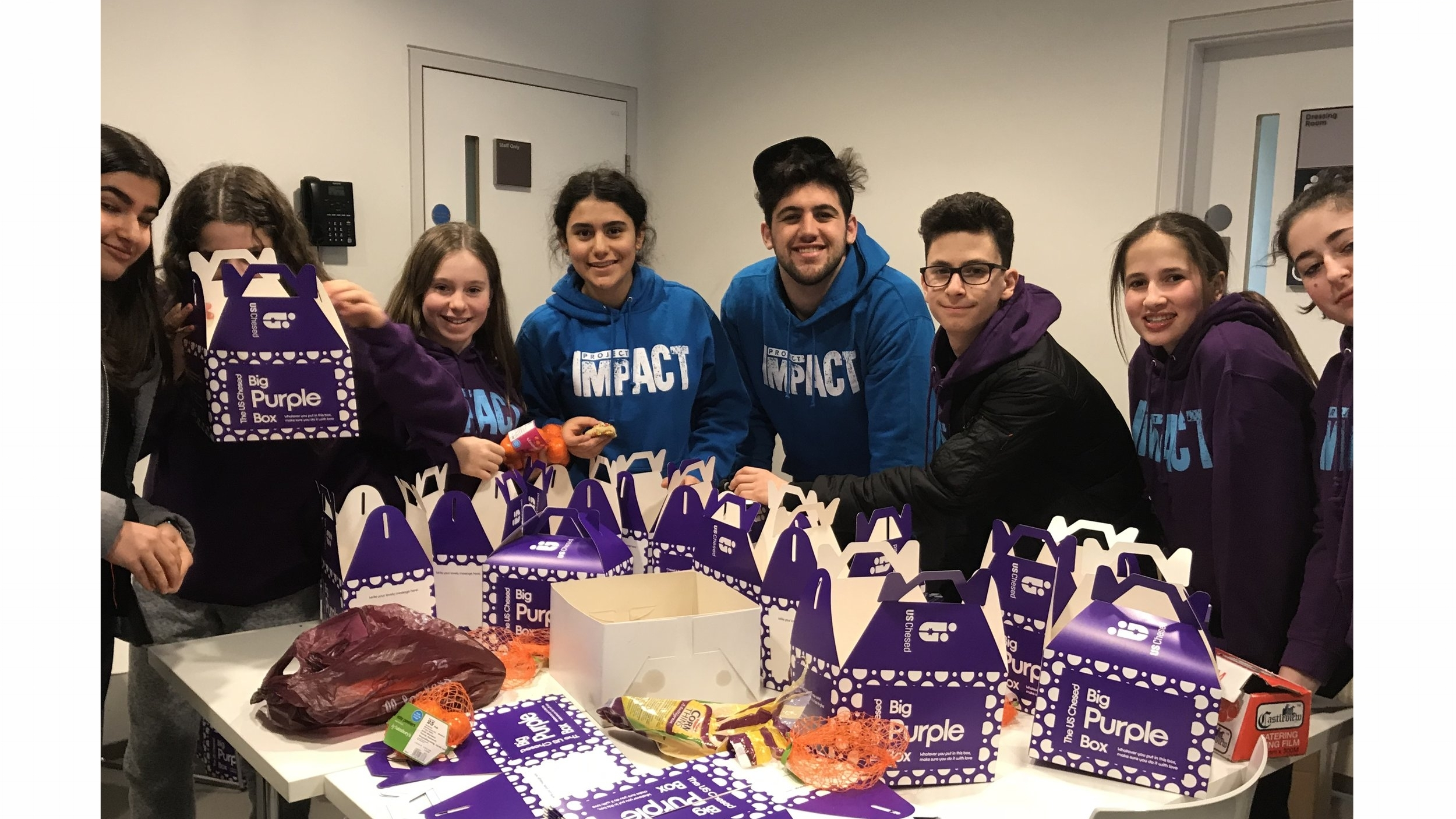 Making Purim boxes for Jewish Blind and Disabled