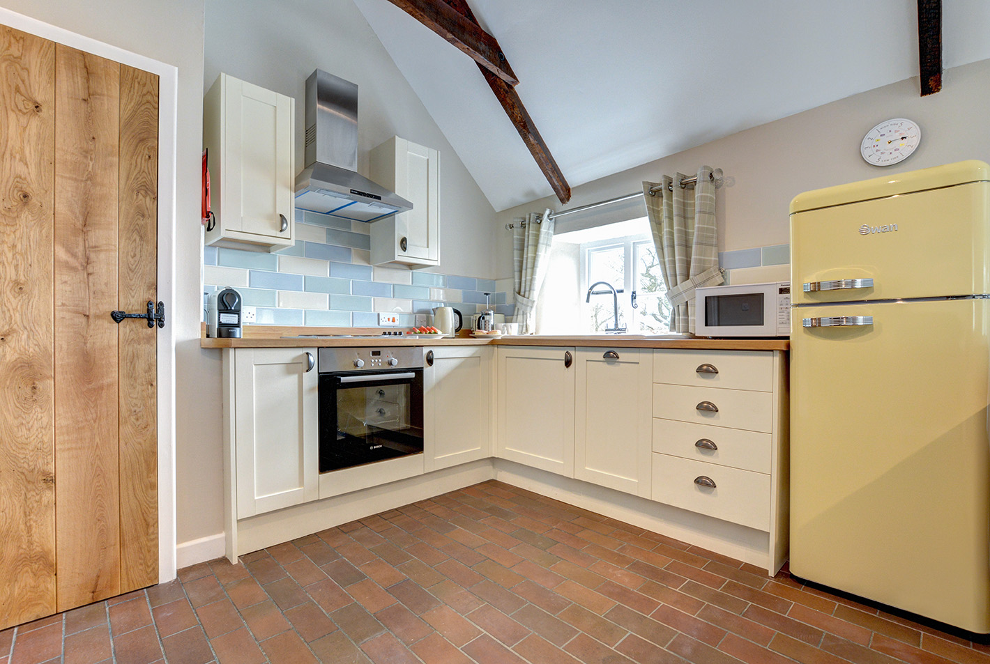 The kitchen of Otterbridge luxury self catering converted barn holiday cottage at Penrose Burden in North Cornwall.jpg