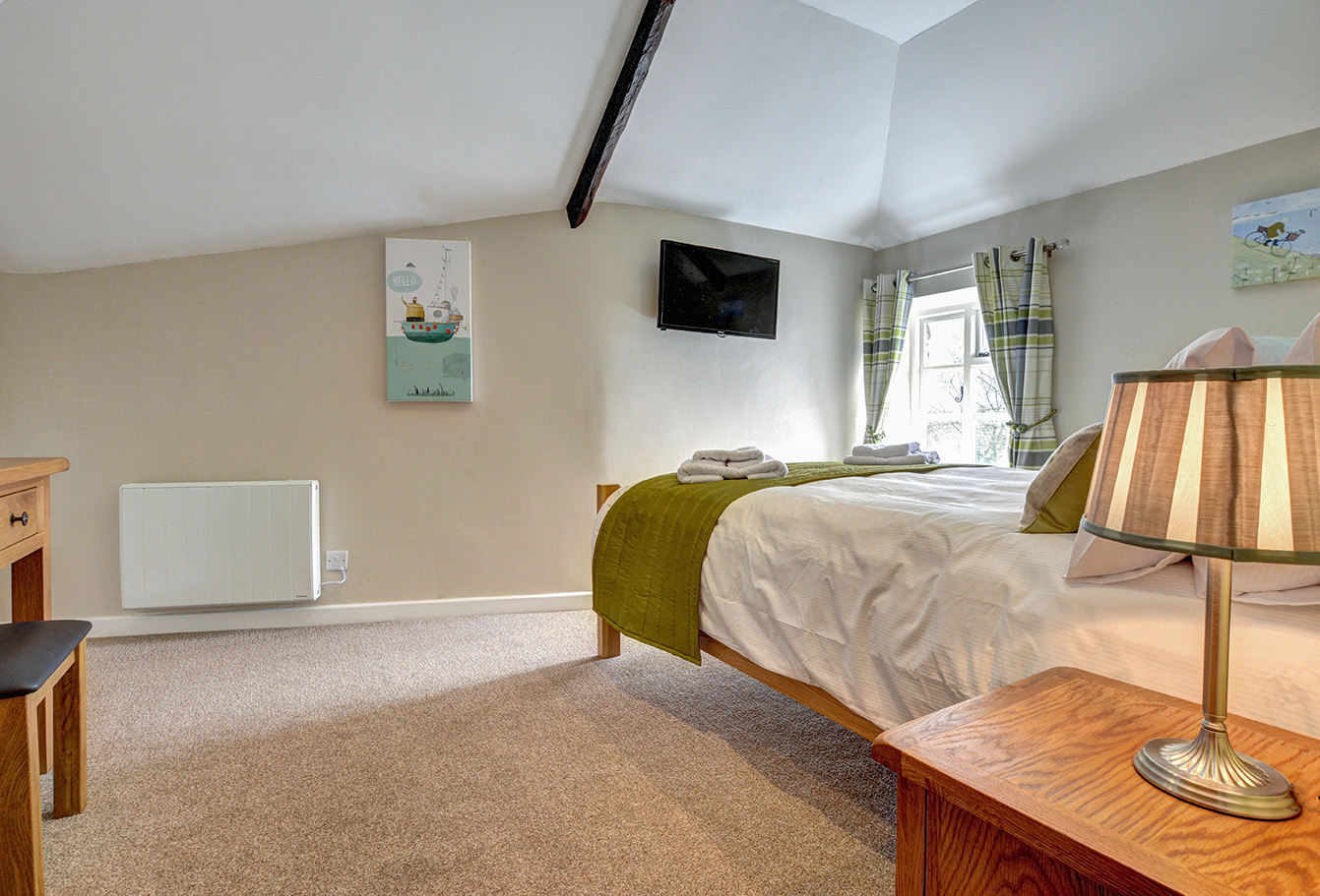 The second bedroom of Otterbridge luxury self catering converted barn holiday cottage at Penrose Burden in North Cornwall02.jpg