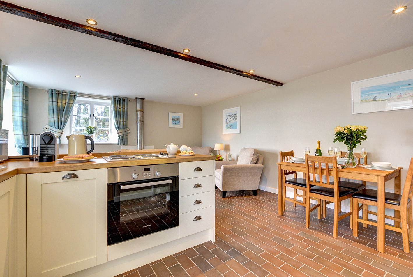 The dining area and kitchen of Butterwell luxury self catering converted barn holiday cottage at Penrose Burden in North Cornwall 02.jpg