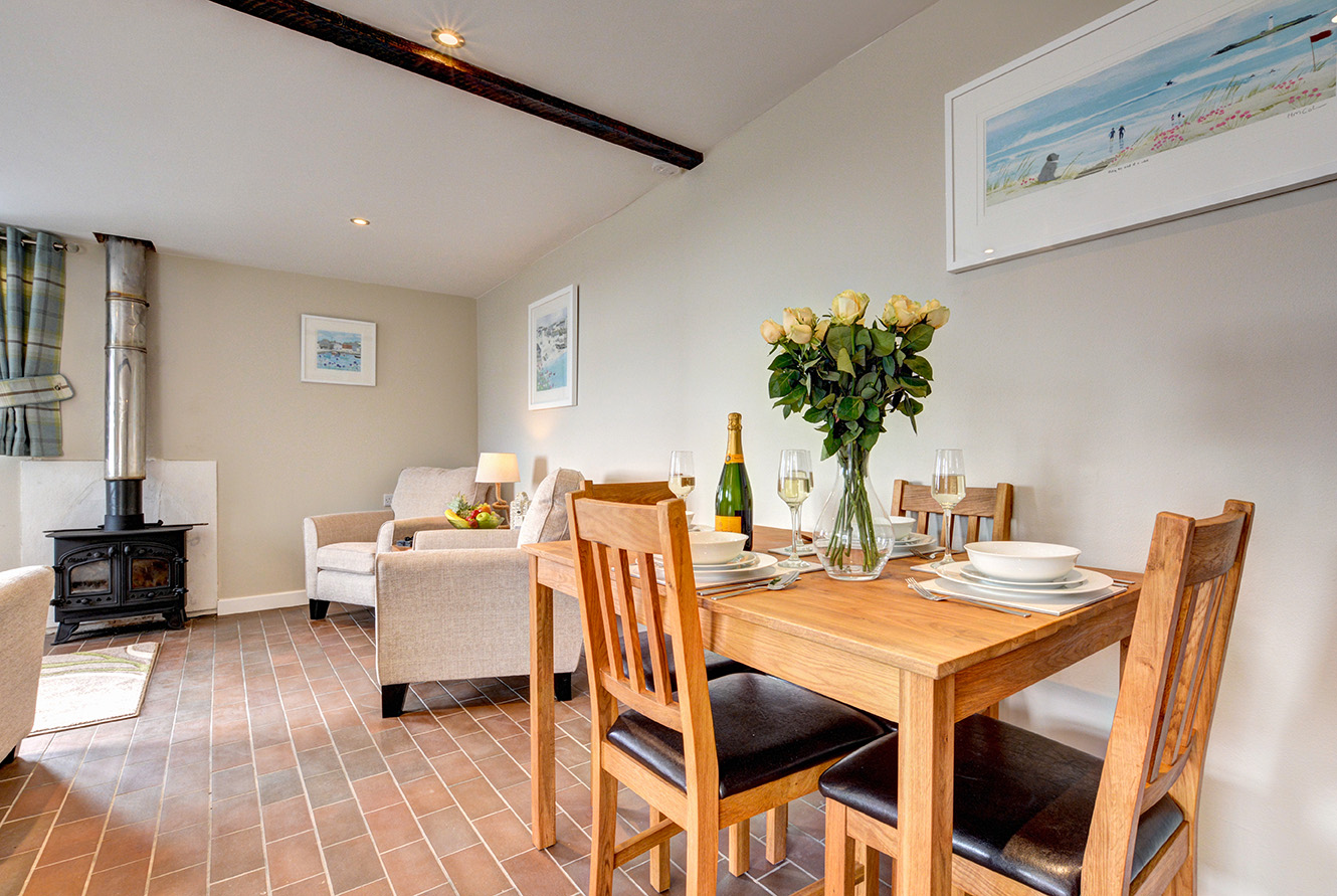 The dining area of Butterwell luxury self catering converted barn holiday cottage at Penrose Burden in North Cornwall 01.jpg