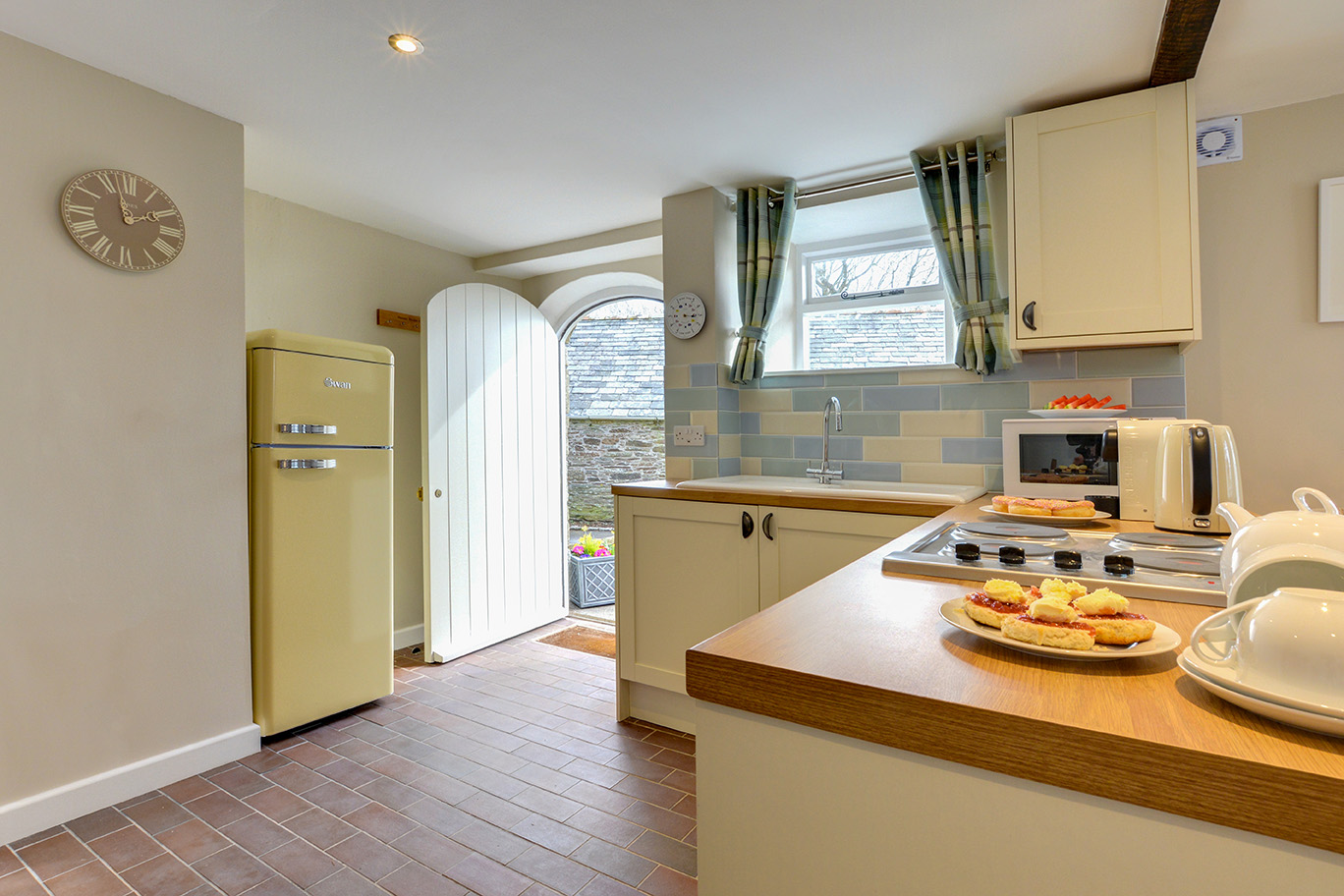 The kitchen of Butterwell luxury self catering converted barn holiday cottage at Penrose Burden in North Cornwall 02.jpg