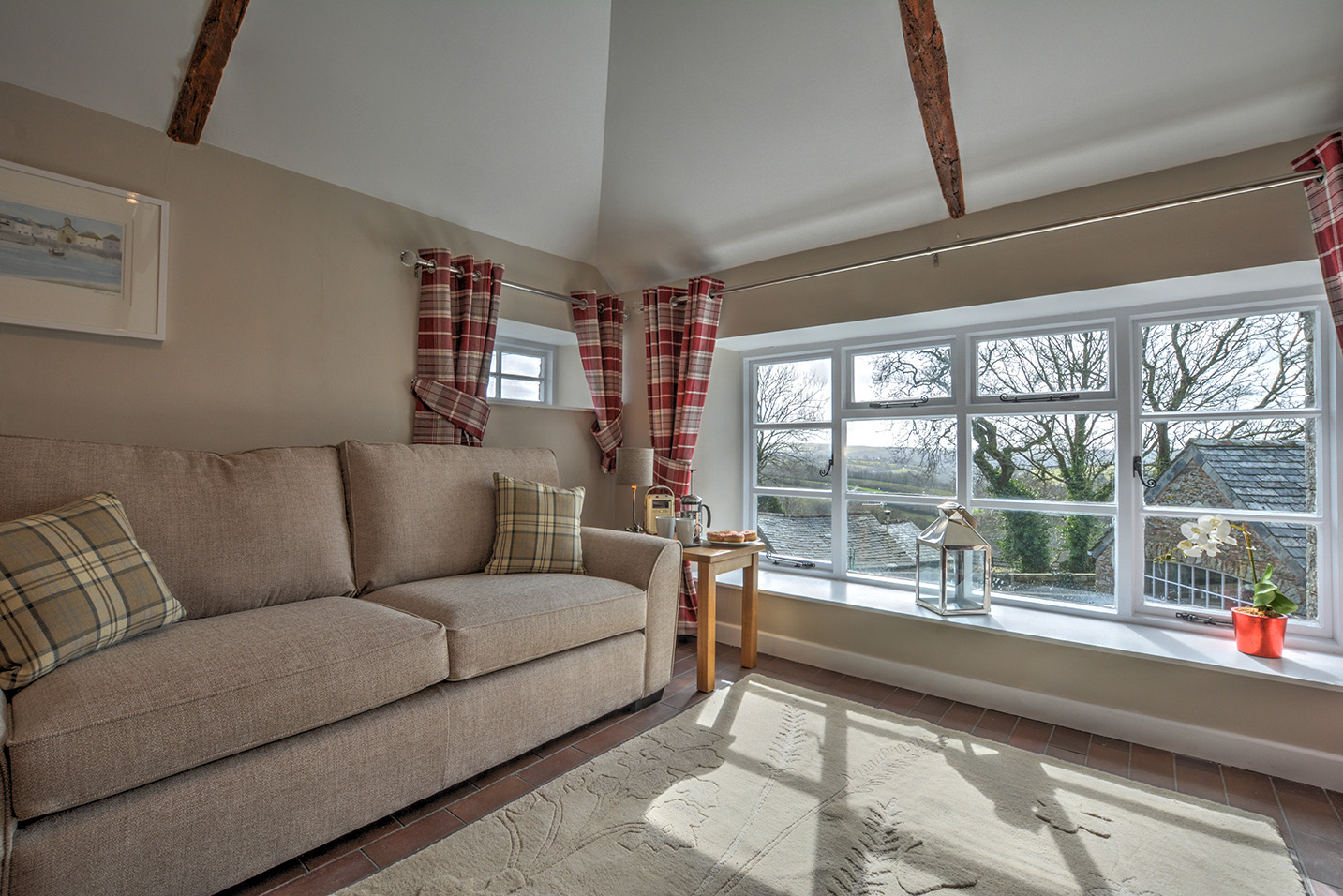 The lounge area of Goosehill luxury self catering converted barn holiday cottage at Penrose Burden in North Cornwall.jpg