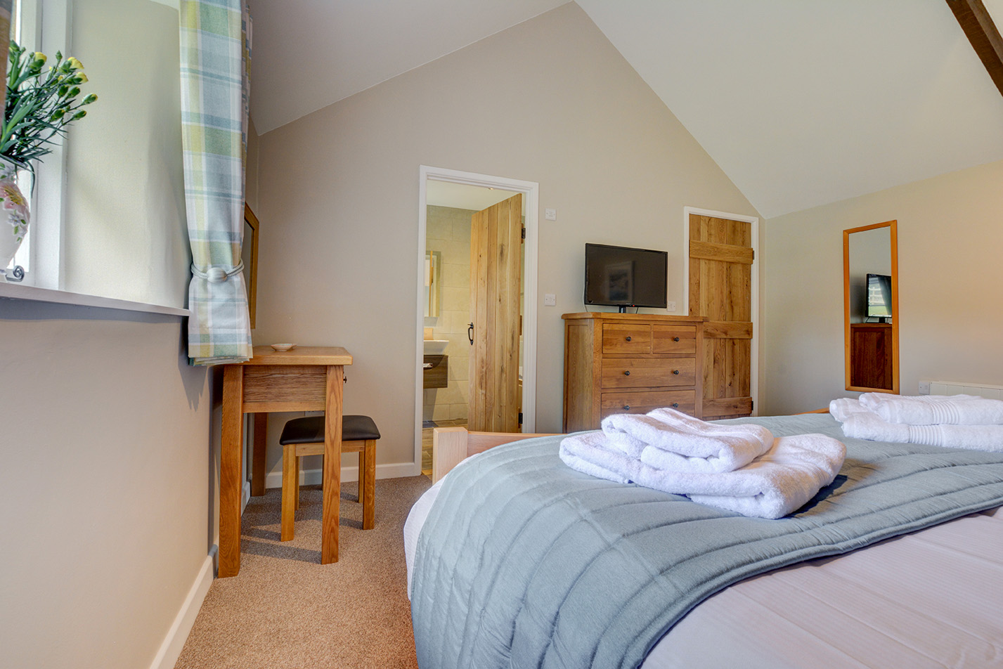 The second bedroom of Goosehill luxury self catering converted barn holiday cottage at Penrose Burden in North Cornwall 03.jpg