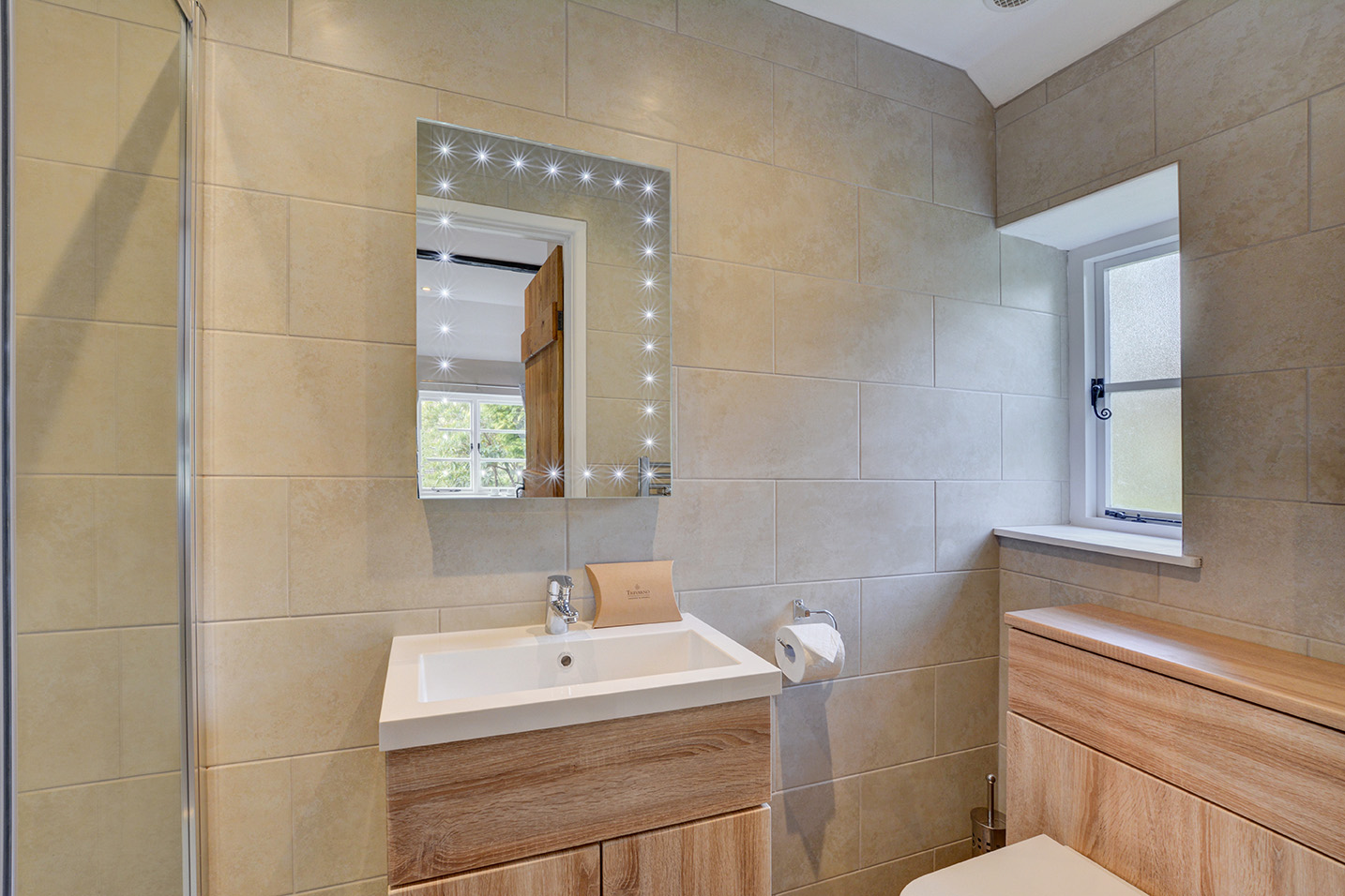 The en-suite shower room of Goosehill luxury self catering converted barn holiday cottage at Penrose Burden in North Cornwall 01.jpg