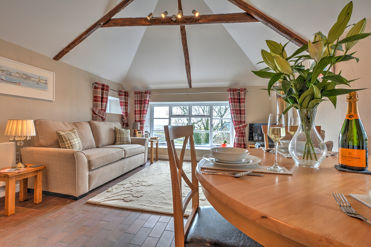 The dining and lounge area of Goosehill luxury self catering converted barn holiday cottage at Penrose Burden in North Cornwall 01.jpg