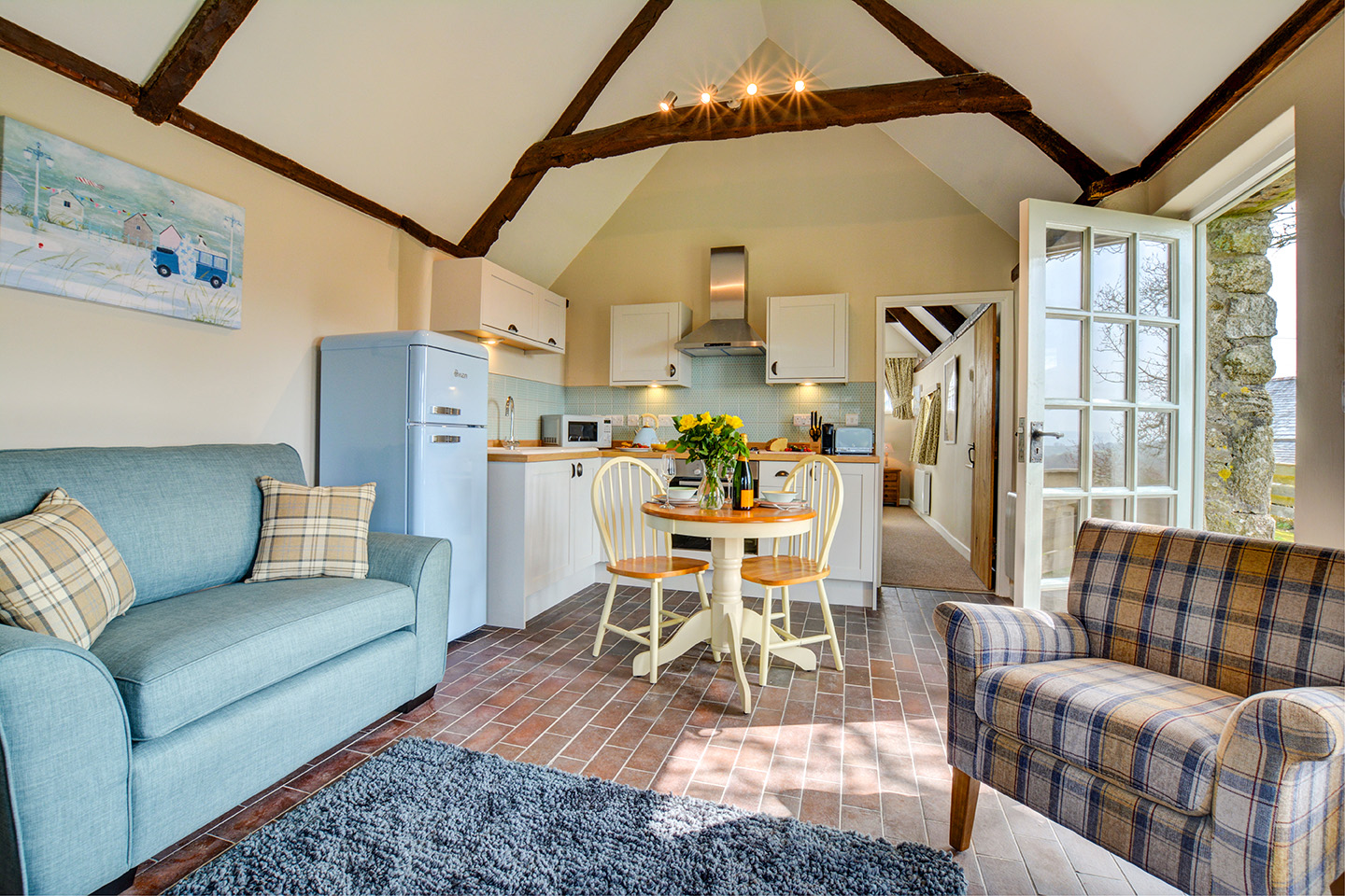 The lounge kitchen diner at Jingles luxury self catering holiday cottage at Penrose Burden in North Cornwall near Bodmin Moor01.jpg