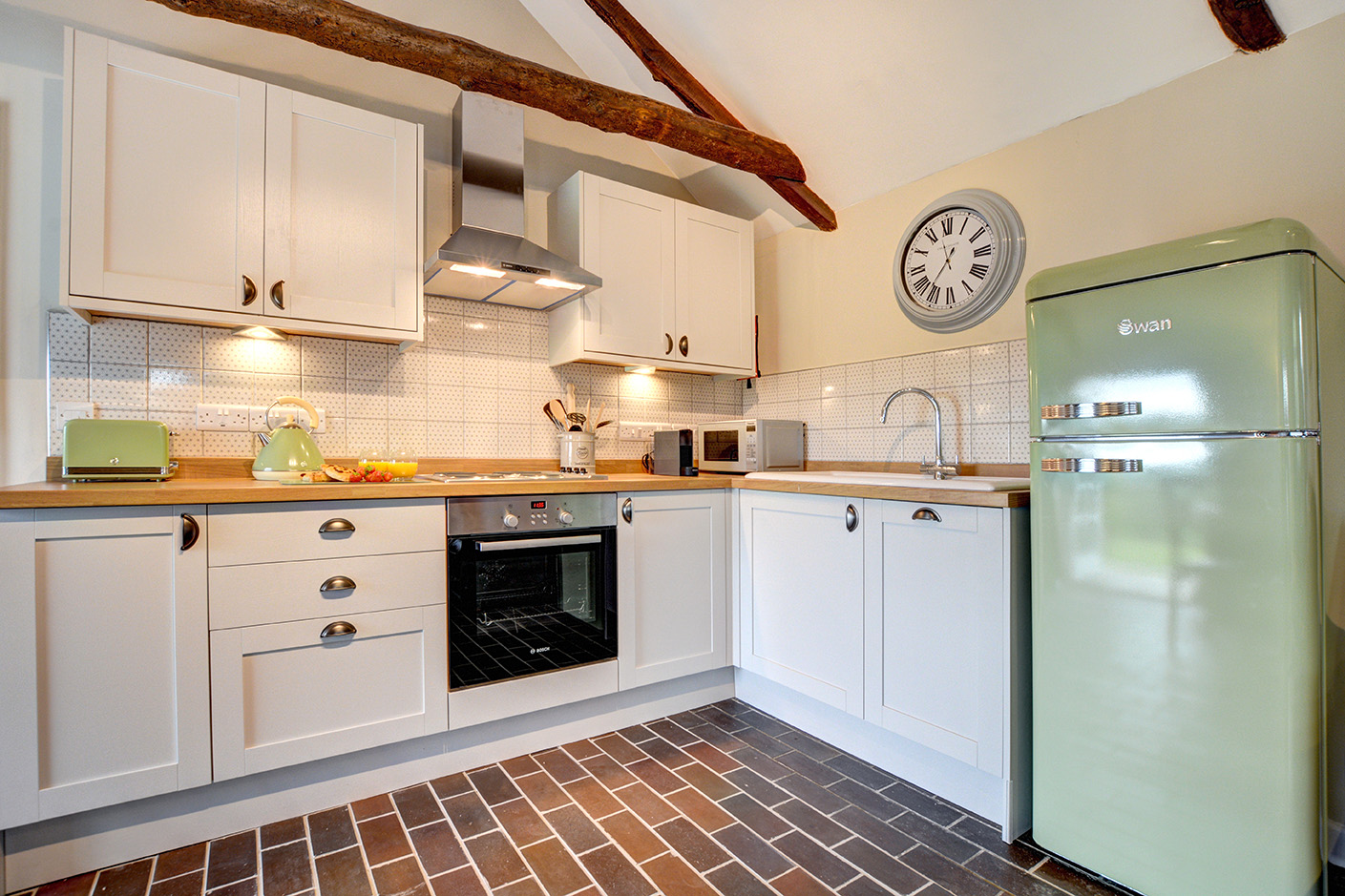 The kitchen area of The Linney self catering cottage converted barn at Penrose Burden holiday cottages in Cornwall.jpg