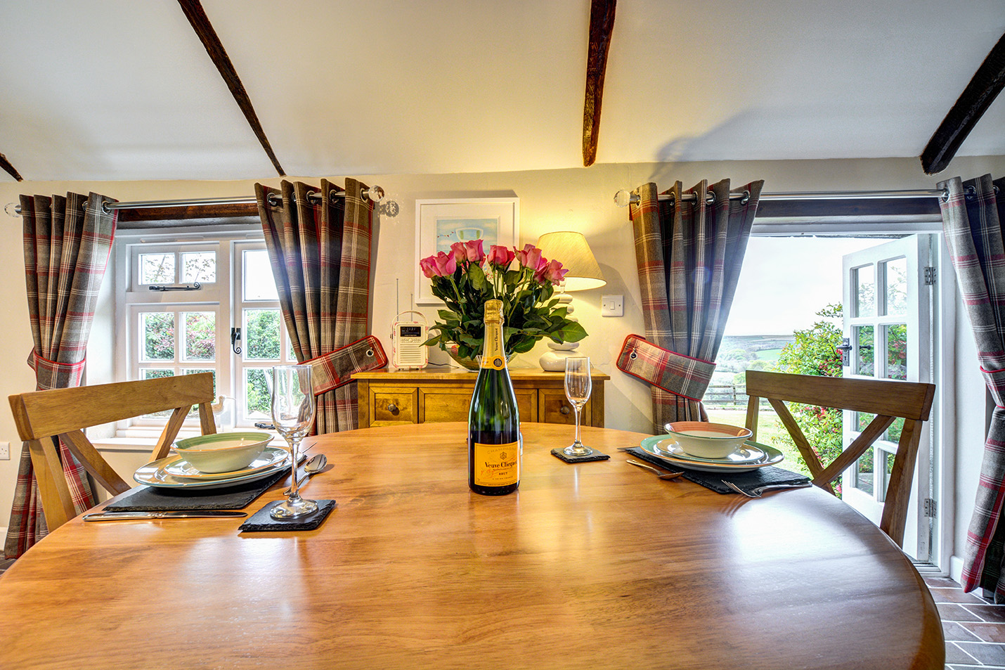 The dining area of The Linney self catering cottage converted barn at Penrose Burden holiday cottages in Cornwall.jpg