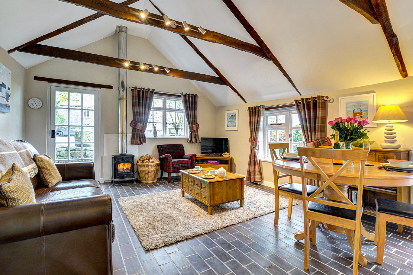 The lounge and dining area of The Linney self catering cottage converted barn at Penrose Burden holiday cottages in Cornwall.jpg