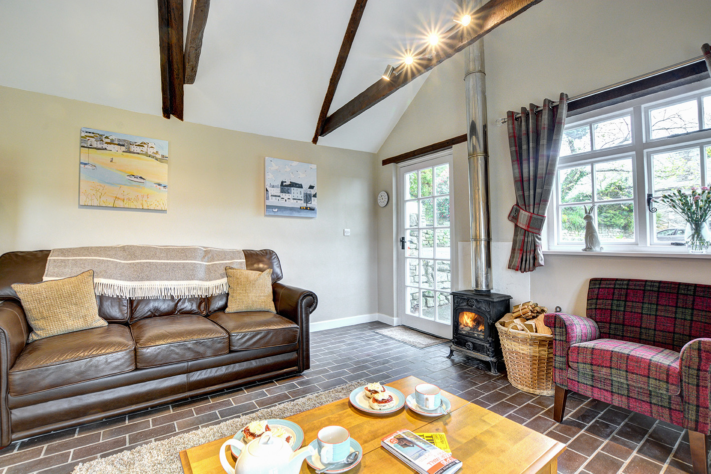 The lounge area of The Linney self catering cottage converted barn at Penrose Burden holiday cottages in Cornwall.jpg