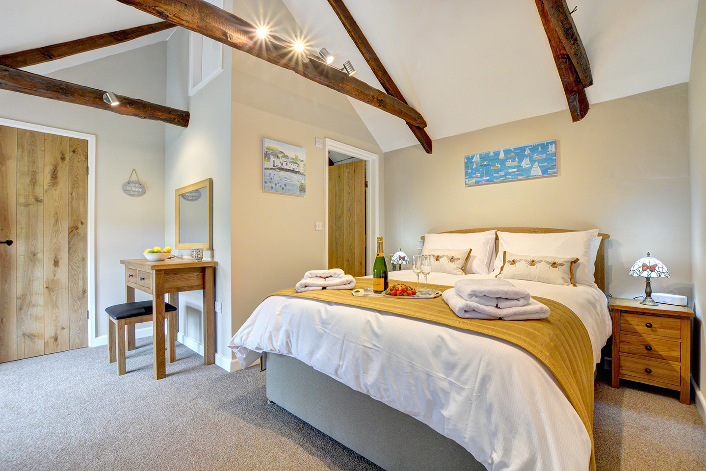 The bedroom of The Linney self catering cottage converted barn at Penrose Burden holiday cottages in Cornwall 01.jpg
