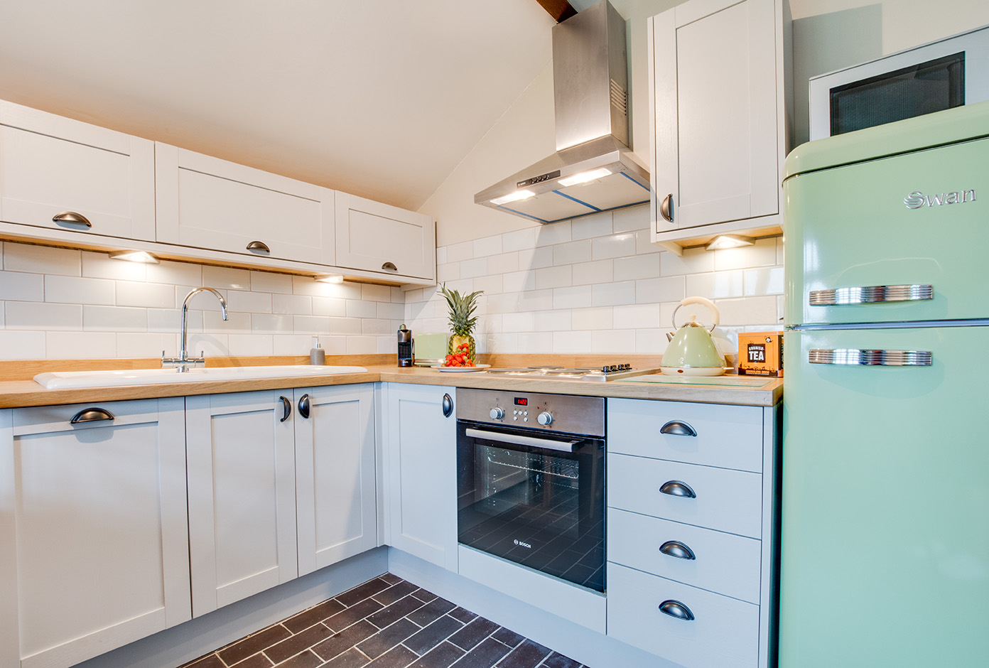 The kitchen area of Snappers luxury self catering converted barn holiday cottage at Penrose Burden in North Cornwall 02.jpg
