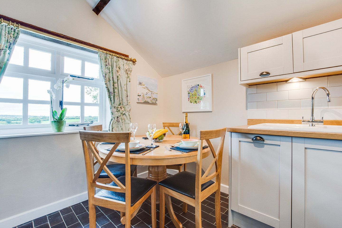 The dining area of Snappers luxury self catering converted barn holiday cottage at Penrose Burden in North Cornwall 02.jpg