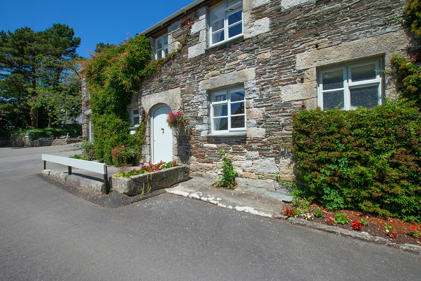 The exterior of Butterwell luxury self catering converted barn holiday cottage at Penrose Burden in North Cornwall 01.jpg