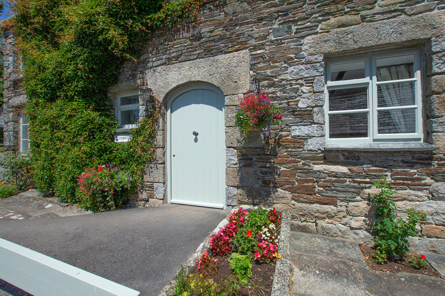The exterior of Butterwell luxury self catering converted barn holiday cottage at Penrose Burden in North Cornwall 02.jpg