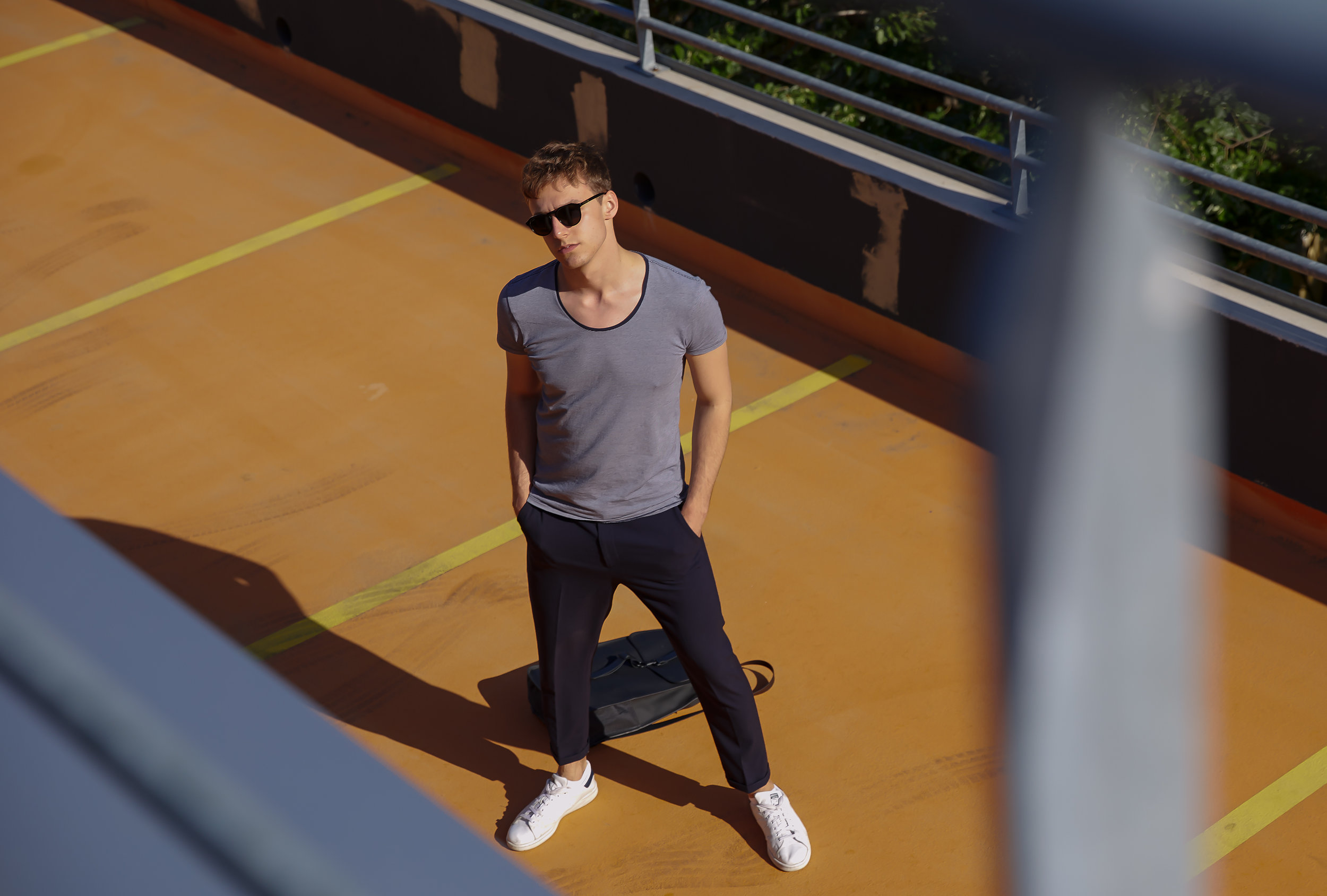 OUTFIT:  T-Shirt: SCOTCH&SODA  Trousers: ZARA  Shoes: ADIDAS STAN SMITH  Backpack: RAINS  Shades: HAWKERS    Photography:   Alexander Sutter