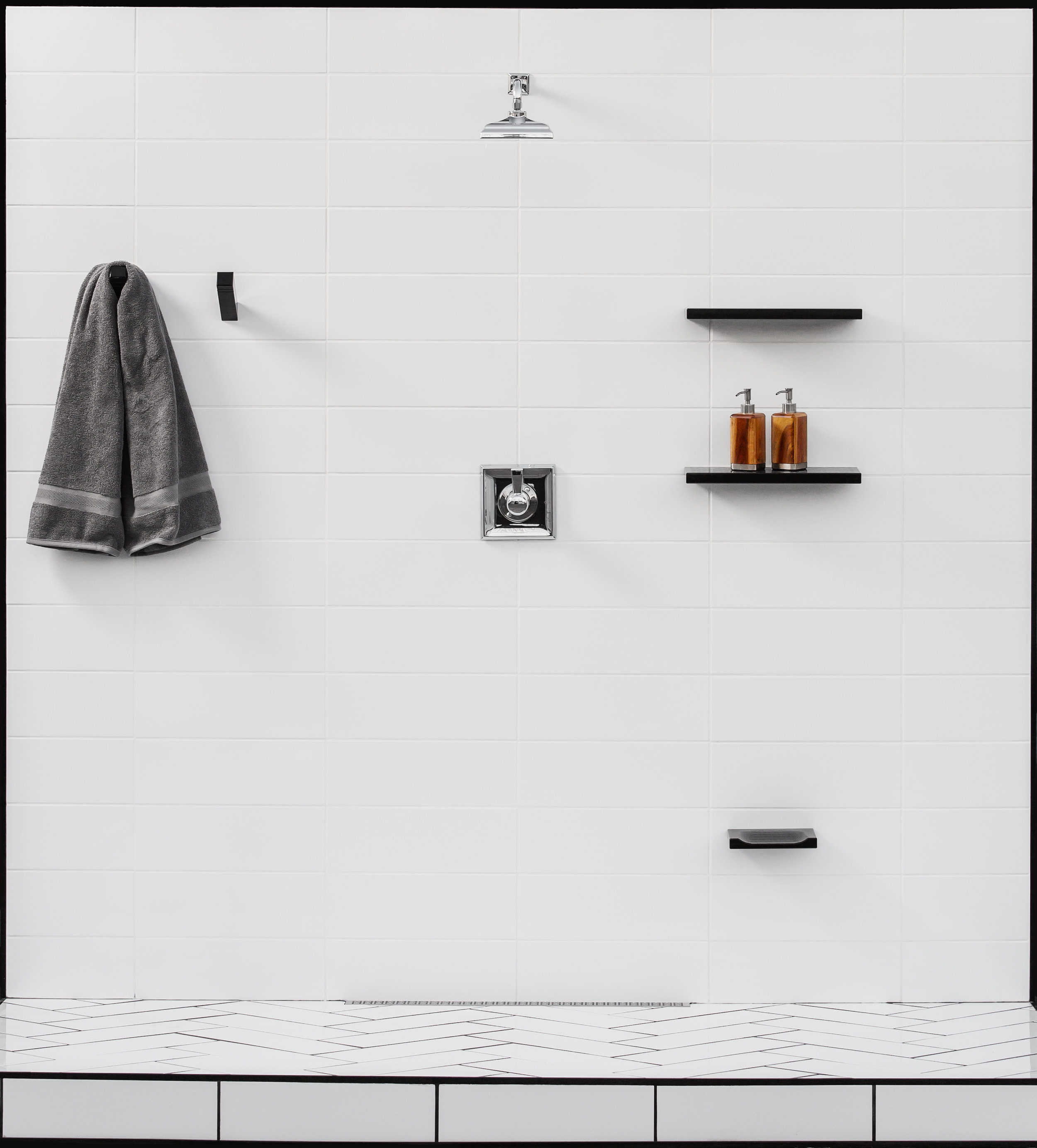 Black Footrest in White Shower With Linear Drain