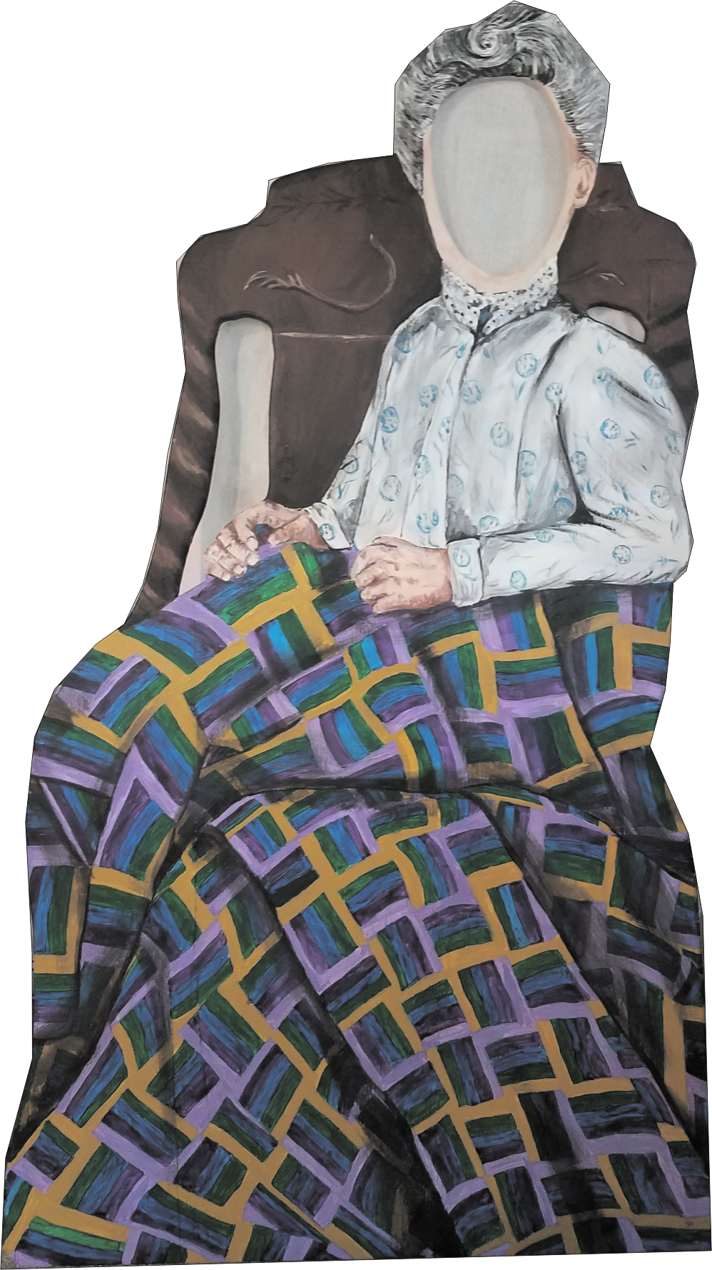 Older lady in chair with 1907 style quilt
