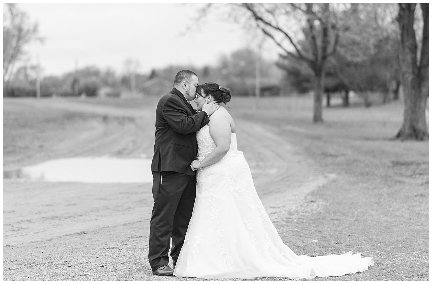 Vendors who made this day possible:  Ceremony: First United Methodist Church - Troy, OH  Reception: Duke Lundgard Building - Troy, OH   Catering: Batdor's Red Barn Catering  Florist: Trojan Florist & Gifts  DJ: Bruce Adamson  Wedding Dress: David's Bridal
