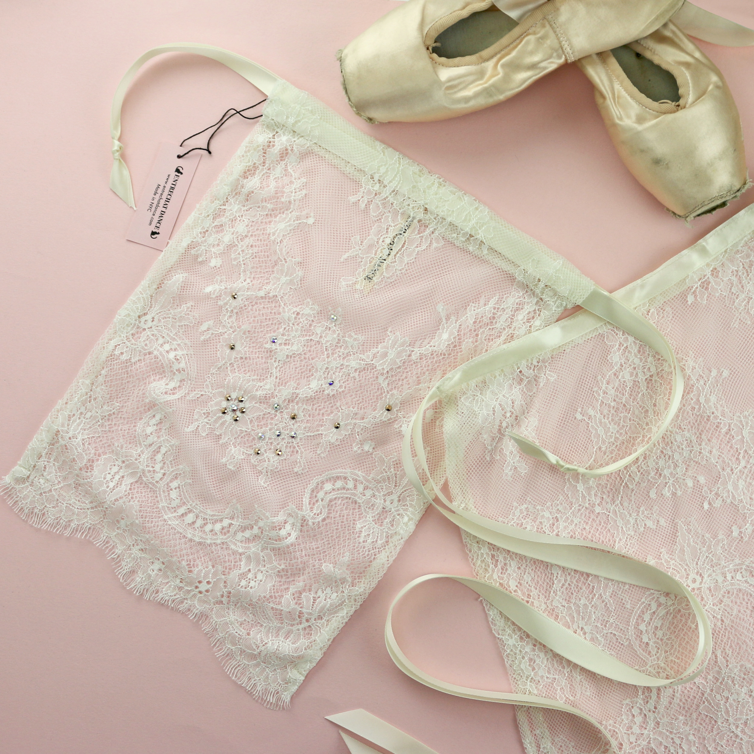 Scalloped Alexandra Lace Pointe Shoe Bag, embellished with genuine Swarovski® Crystals, makes a perfect pairing with our Alexandra Lace ballet wrap skirt.