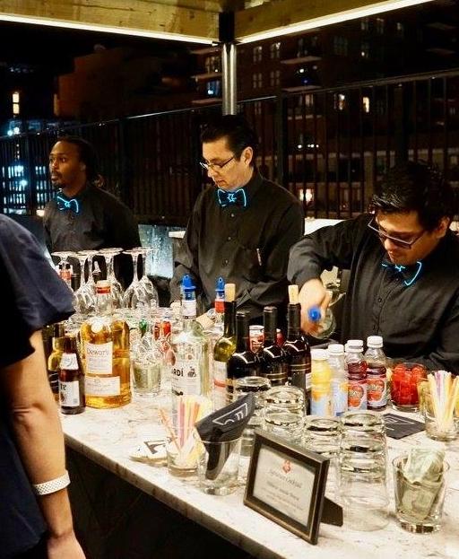Bartenders served guests wearing neon bowties.