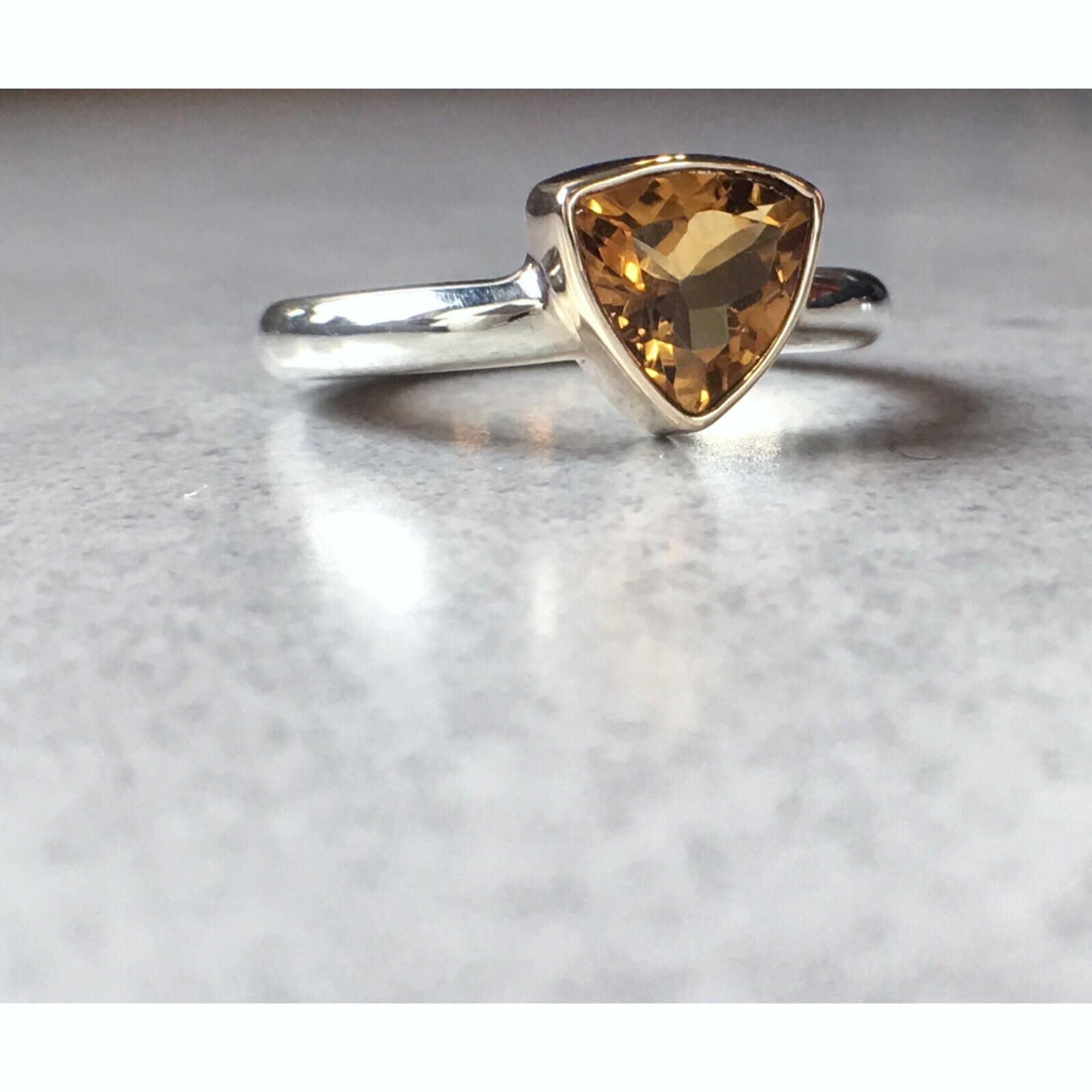 Bespoke Engagement Ring 2019 - 9ct white and yellow gold and a trillion cut citrine stone.