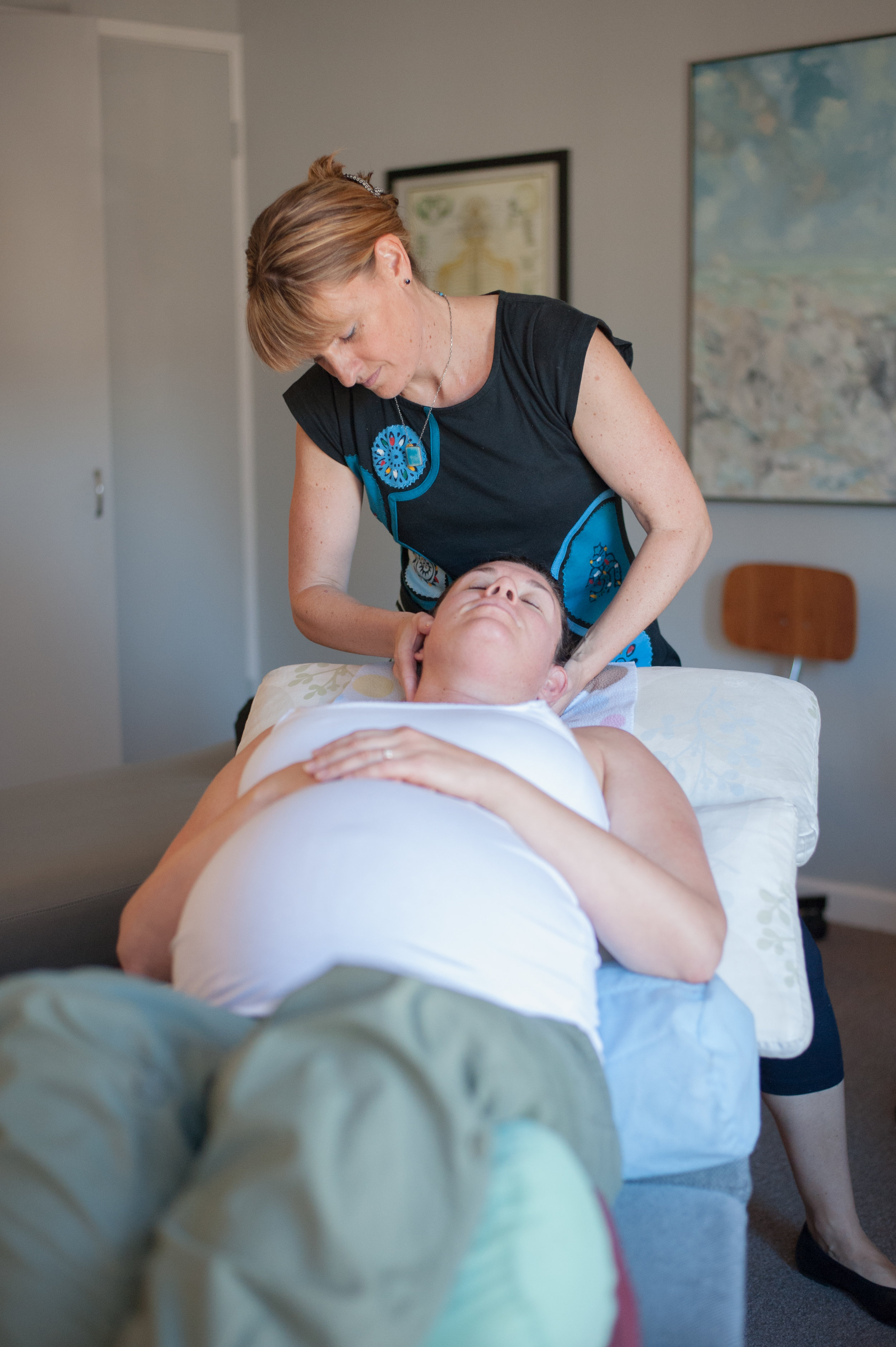 Dr. Danielle McLane-da Silva adjusting prenatal mother