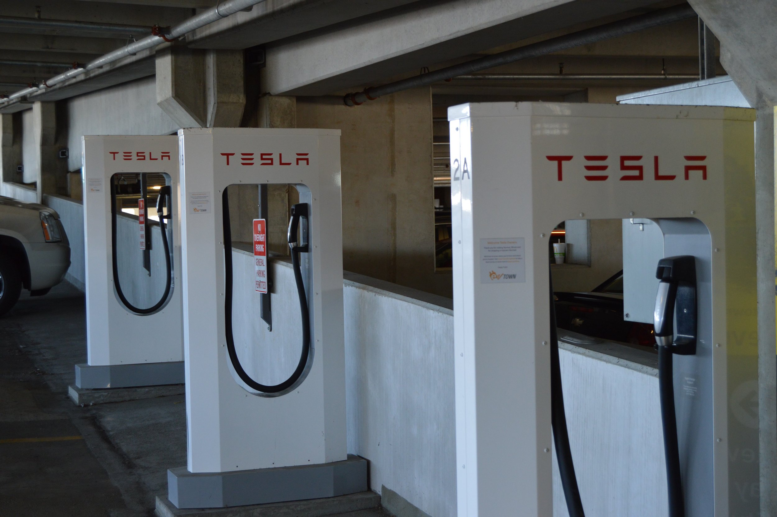 The four Tesla Supercharing stations in the Uptown Station parking garage. (Christian Prenzler for AdaptBN)