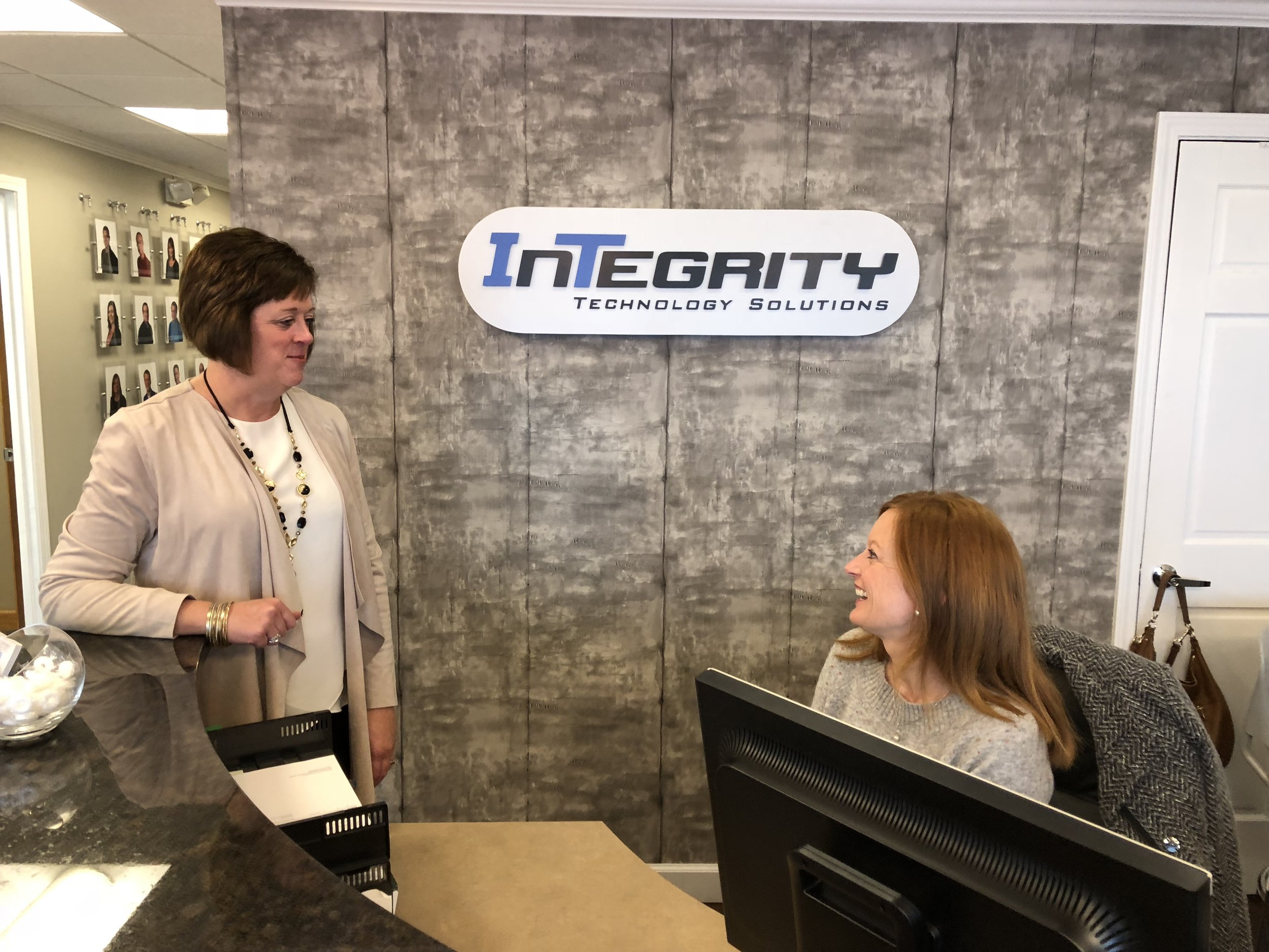 Mary Bennet Henrichs talks business with associate Cindy Giessinger at Integrity Technology Solutions. (Credit: Erik Prenzler)