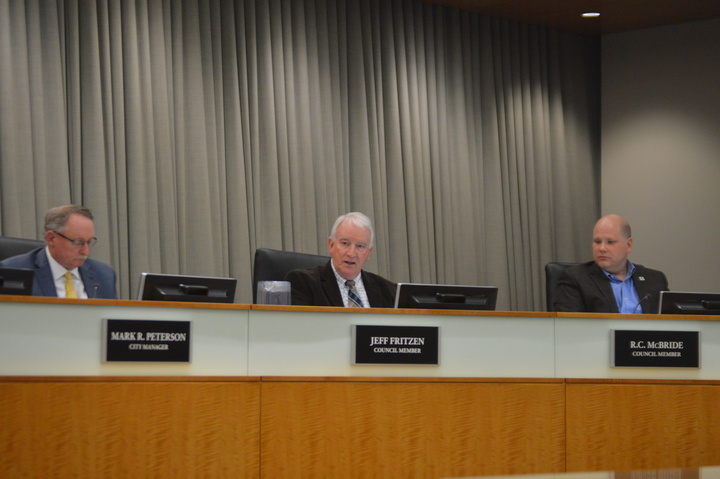 Normal Town Council member Jeff Fritzen speaks on the Trail East project Tuesday. The Council unanimously authorized the Town to begin negotiations for a development agreement with Bush Construction for its proposed $29.2M building at Uptown Circle. (Credit: Breanna Grow.)